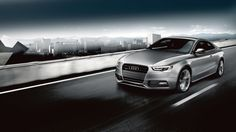 Audi A5 Coupe quattro shown in Ice Silver metallic with available equipment