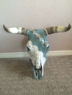 DIY cow skull with lace, pearls, and rhinestones