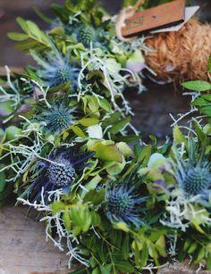 metallicblue eryngium, peagreen hellebore, mixed foliage wreath design, zetas tradgard