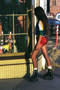Roller Skates, red hot pants with a jersey and Long brown hair.