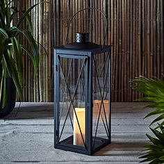 Tall Black Metal Battery Operated LED Flameless Candle Lantern for Indoor Outdoor Use. For product & price info go to:  https://all4hiking.com/products/tall-black-metal-battery-operated-led-flameless-candle-lantern-for-indoor-outdoor-use/