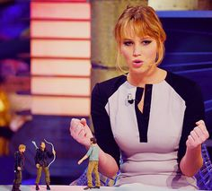 VIDEO: Currently Jennifer Lawrence is in Spain promoting 'The Hunger Games'. One of the stops on her tour was to the Spanish Television show, el Hormiguero. Jen plays an archery game, lights a giant Mockingjay on fire, talks about her action figure and much more! Click the picture to take a look!