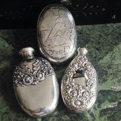 Three antique sterling flasks circa The flask depicting a monk dozing by the cask (acid etched engraving) measures long. The other two flasks measure around long Bottle Necklace, Vintage Perfume Bottles, Silver Accessories, Flasks, Antique Silver, Christmas Bulbs, Antiques, Holiday Decor, Smoking