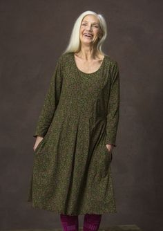 "Enjoy laid-back feel-good in this lush eco-cotton jersey dress with its playful ""Blueberry"" pattern. Box pleats at the waist with three-quarter length sleeves. Picot trim at the bottom hem and sleeve hem as delicate detailing."