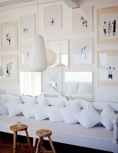 I like the framed monochromatic illustrations ..Paola Navone