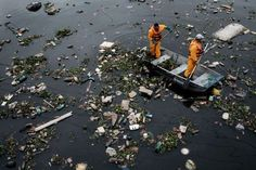"""GUANABARA BAY, BRAZIL Floating debris carried by the tide are caught by the """"eco-barrier"""" before entering Guanabara Bay, at the mouth of Meriti River in Duque de Caxias, next to Rio de Janeiro. The Bay drew global attention in the run-up to the 2016 Olympic Games, when concerns about athletes' health resulting from polluted waters cropped up."""