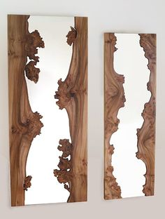 For my nature inspired guest bathroom.  Mirrors cased in living edge wood.  By Caryn Moberly