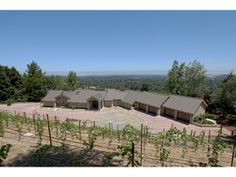 25 Oakhill Dr. Woodside, CA 94062 Exclusive listing. Fully renovated modern Vineyard Estate in central Woodside. Panoramic views of the Peninsula throughout: East Bay Hills t...