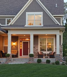 Great use of columns, trim and lighting to create an inviting outdoor living space...doesn't it make you want to visit?