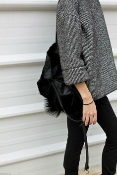 Chunky grey sweater, and black skinnies