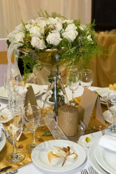 table with gold runner and huge martini glass as holder