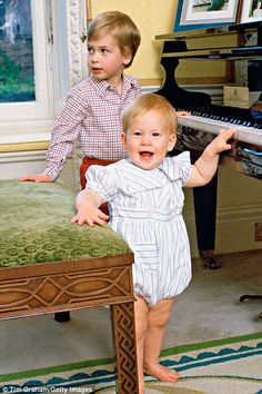 Pictured, Prince Harry and Prince William enjoy playing the piano together at Kensington Palace