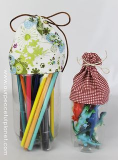 Organize, Upcycle and Craft all in one feel swoop! These little carryalls are made form soda bottles. Make them any size you wish. What a fun way to store small items!