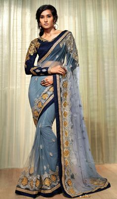 Everyone will admire you when you wear this ash gray embroidered net saree. Beautified with resham and stones work. #GorgeousTrendsetterSaree