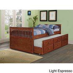 You'll create additional storage space and an extra sleeping space for guests with this captains trundle bed. This timeless design features 100-percent solid pine construction and is mattress-ready.
