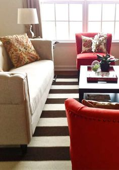 I like the stripes on the rug and the red chairs