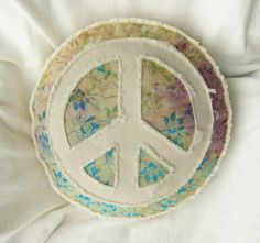 Peace sign applique boho pillow on multi color tropical floral batik with aqua, yellow and purple with distressed natural denim round pillow...