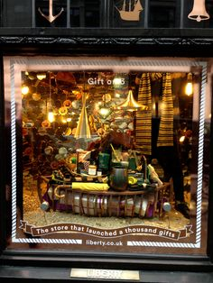 #Christmas windows 2014: Liberty, Regent Street. We ADORE Liberty's concept: The Store That Launched A Thousand Gifts! Like something you see? Each window has it's department location - great sell! #visualmerchandising #VM