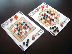 Coffee is a two-player abstract board game designed by Néstor Romeral Andrés. The goal of the game is to create a line of stones of your color, or to prevent your opponent from making a legal placement of the white rod. When placing the rod in a black or orange stone, it looks like a coffee seed. Hence the name Coffee. This is what you need in order to play Coffee: A hexagonal board with more than 3 cells per side or a square board with more than 4 cells per sid...