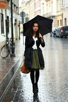 This olive skirt is adds the right about of color for this rainy day outfit.