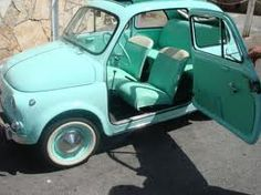 i'd love a Christmas tree atop a Fiat and kids hanging out windows!  Where can i get a fiat 500??