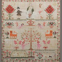 Bonhams 1793 : An early 19th century sampler depicting a tree of life with Adam and Eve