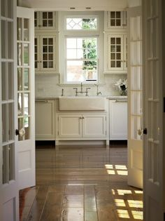 French doors leading into beautiful country kitchen. Farm house sink, whatever t. French doors leading into beautiful country kitchen. Farm house sink, whatever the horizontal window above the window is. Home Design, Interior Design, Interior Doors, French Interior, Interior Modern, Glass Front Cabinets, Kitchen Cabinets, Kitchen Sinks, Deco Design