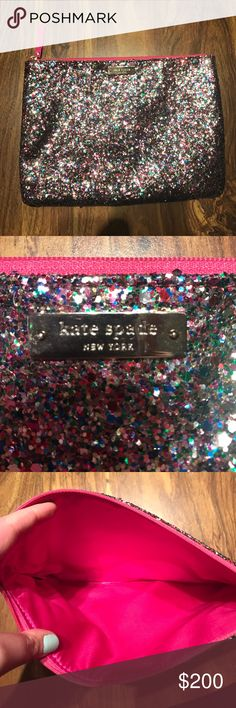 Kate Spade Clutch NWOT multi-color glitter Kate Spade zip clutch. Lots of room for anything you need on a Date night, weekend trip, or everyday use! Pink inside, brand new! kate spade Bags Clutches & Wristlets