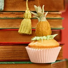 Serve a perfectly pineapple cupcake! Bake pineapple cupcakes and top with green icing. Then paint walnuts yellow and stack on top. Finish with a little bit of green icing for the pineapple stem.