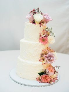 Cascading floral topped wedding cake: http://www.stylemepretty.com/little-black-book-blog/2015/11/16/rustic-stone-manor-country-club-wedding/ | Photography: Krista A Jones - http://kristaajones.com/