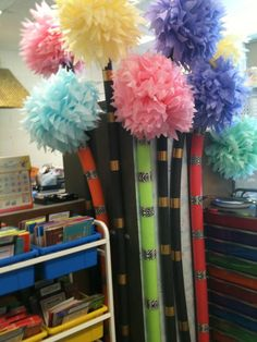 Truffula trees (Dr. Seuss) in my classroom. Made with tissue paper, pool noodles, pipe insulators and duct tape.