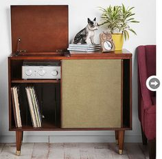 Get the Mad Men look with mid-century modern decor ... like this hardwood and ash media console.