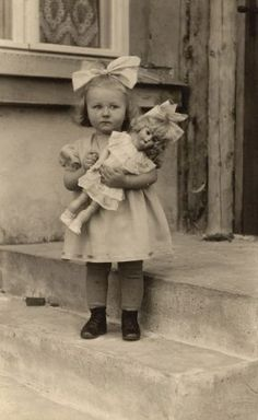 Little girl with her doll in the 1940's