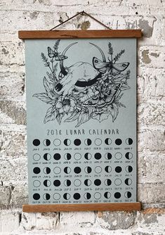 2018 Lunar Calendar, image drawn and hand screen printed by me! Phases of the moon for the year of 2018 in the Northern Hemisphere adorned with a raccoon skull, crescent moon, moths, moon flower, and lavender. A great way to stay in touch with the moon cycles! 11 by 17 on a medium weight