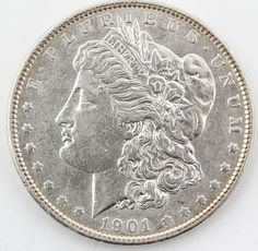Lot 21 in the 8.5.14 online & live auction! Extremely rare date 1901 Morgan Silver Dollar, consignor graded CHOICE condition, Philadelphia minted 6,962,000. Beautiful coin to add to any collection. #Currency #Money #Numismatics #Bullion #POGAuctions