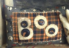 Primitive Halloween decorative pillow BOO. $14.85, via Etsy.