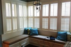 Wood shutters - what a great solution for a sunroom! Wouldn't you love to curl up here with a good book?
