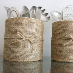 Where to keep all those kitchen gadgets? Turn those old coffee containers into new kitchen utensil canisters!