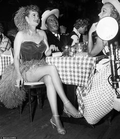 Lucille Ball, front left, and her husband Desi Arnaz in costume at the club in May 1956 for a fundraiser.