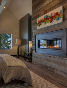 the essence of the good life peis med trepanel fireplace with wood panels lodge pinterest woods fire places and mountain modern