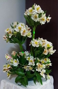 Alstromeria bunched are an inexpensive flower that looks like a million in this wedding centerpiece
