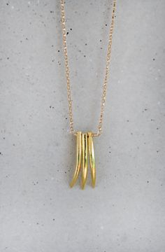 Gold Triple Tusk Necklace.