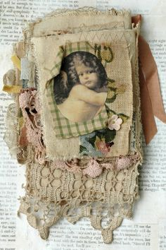 Mixed media fabric collage book of cherubs