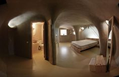 super adobe house made from earth filled sandbags.