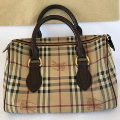Authentic Burberry Brown Leather Bag Durable, good condition. Rich dark brown color. Clean interior and exterior. No dirt nor scratches. Scuff marks noted on handles (3rd pic). Burberry Bags