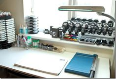 LOVE this idea from Monica Gale's scraproom.  Punch storage using a metal shoe rack from Ikea!