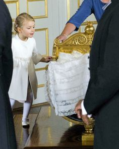 swedishmonarchy:  Christening of Prince Nicolas of Sweden, Drottningholm Chapel, October 11, 2015-Princess Estelle sneaking a peek at her little cousin Nicolas; she will become a big sister in March 2016