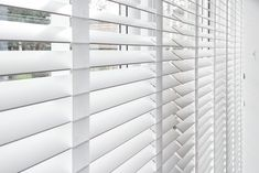 Detail of pure white wood venetian blinds we installed. http://www.theblindshop.com