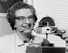 Nancy Grace Roman, c. 1963, with a model of the Orbiting Solar Observatory