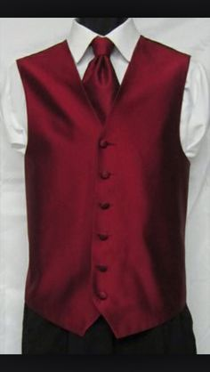 Groomsmen will be wearing burgundy vest with blue jeans! There will be four of them.